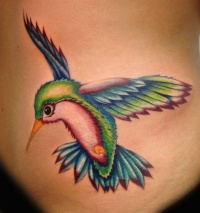 Realistic coloured hummingbird tattoo