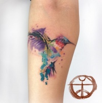 Colour splashes hummingbird tattoo