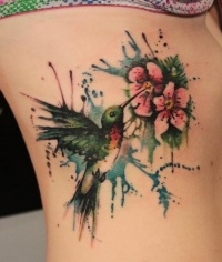 Paint splash hummingbird tattoo