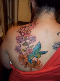 Colourful hummingbird tattoo for women
