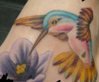 small hummingbird tattoo design
